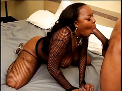 Ebony With Big Naturals In Fishnets Blowing A Black Cock