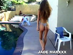 Leggy Brunette With A Ripe Ass Kneels Down On Pool Deck And Sucks Big Cock