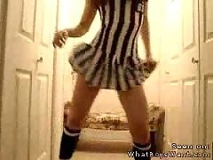 Sexy cheek dancing on webcam in a striped dress