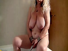 Granny Dana 66 Strips And Masturbates